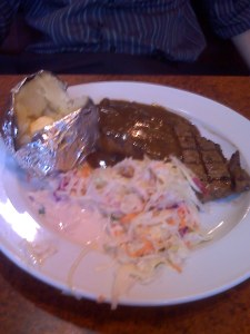 Kim's steak with sides - baked potato and coleslaw